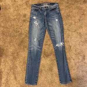 AEO light wash jeans with holes super skinny 0